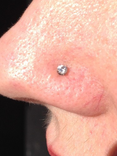 Nostril Piercing With A Genuine Prong Set Diamond